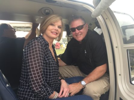 Karen Espinosa and husband in helicopter