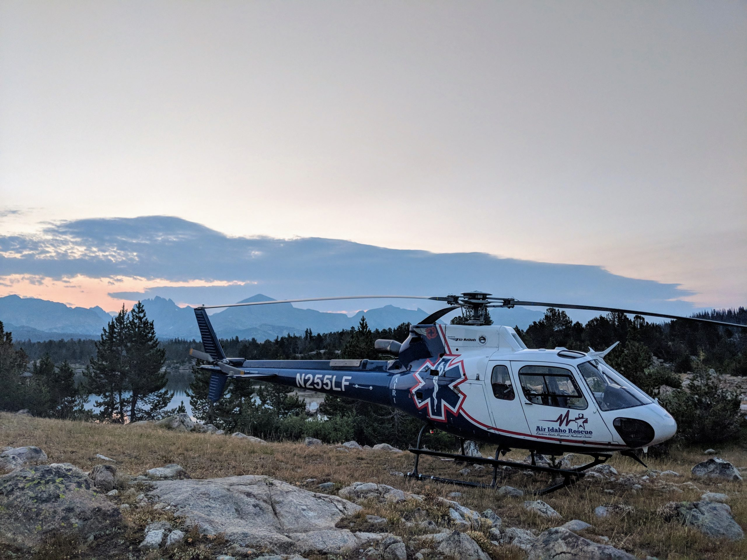 Air Idaho helicopter landed on mountain.