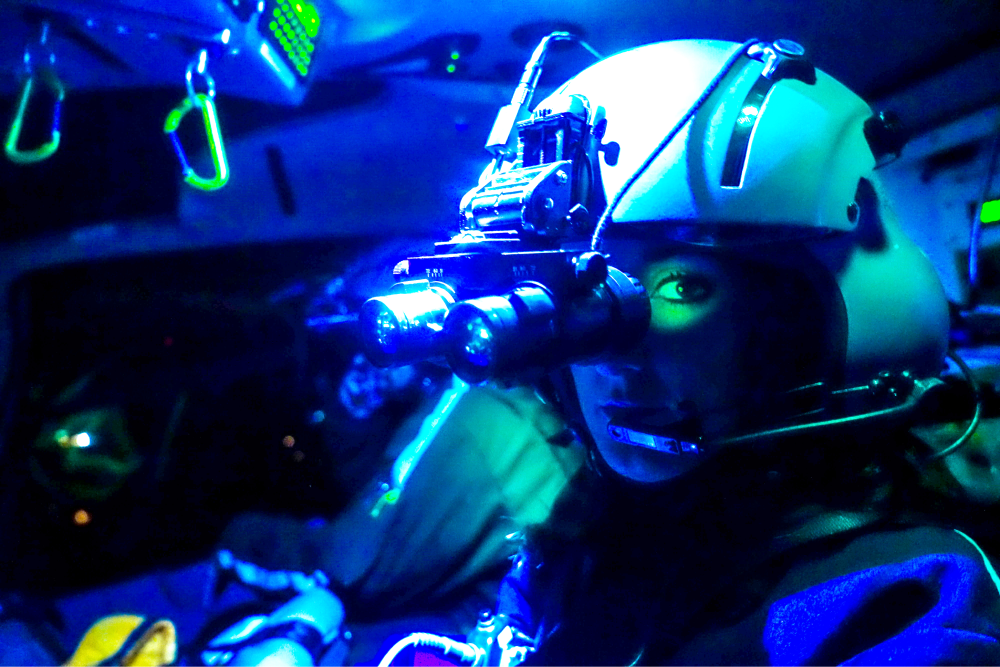 Pilot wearing night vision goggles.