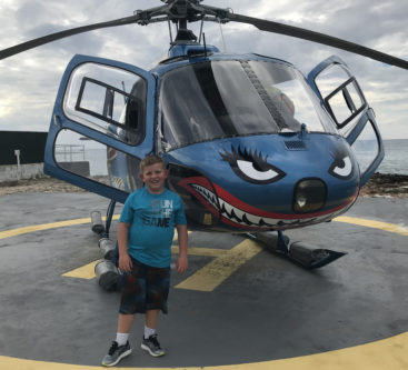 Sam Soulek in front of helicopter